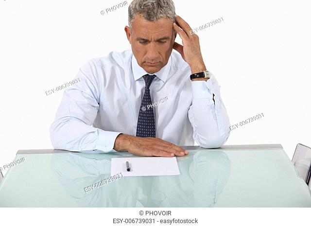 Confused businessman reading document