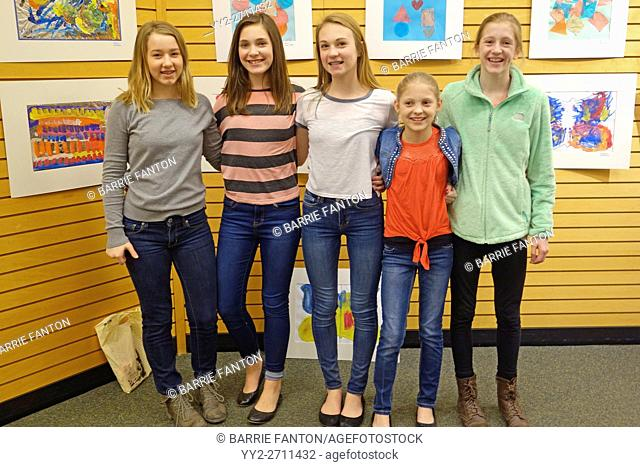 Preteen Girls Posing in Book Store, Rochester, New York, USA
