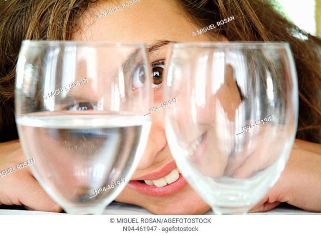 Rebeca looking through two glasses empty restaurant Don Baco La Cañada, Valencia, Valencia, Spain