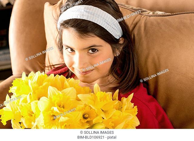 Hispanic girl holding flowers