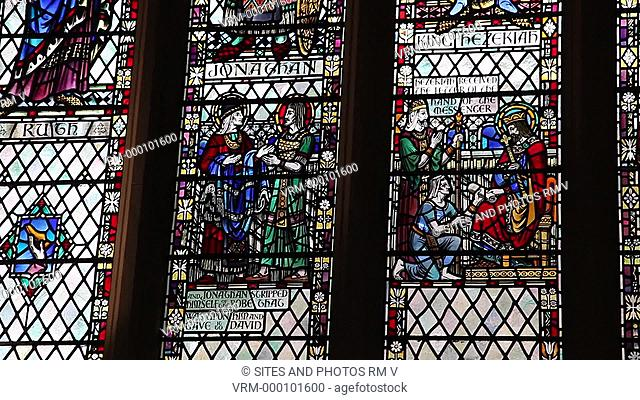 TILT up, CU, interior, stained glass window showing Ruth, Jonathan, King Hezekiah and Nehemiah. The former cathedral contains 52 windows that occupy 80 percent...
