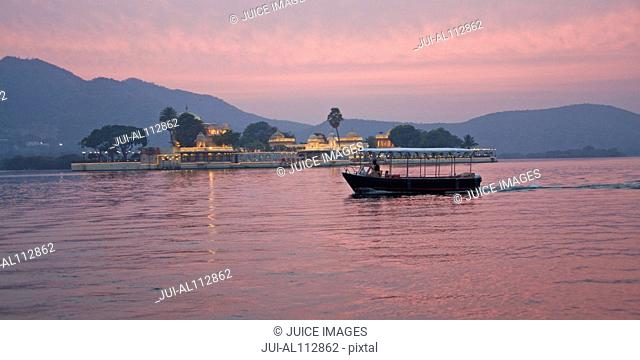 View of Jag Manir Palace at dusk, Udaipur, Rajasthan, India, South Asia