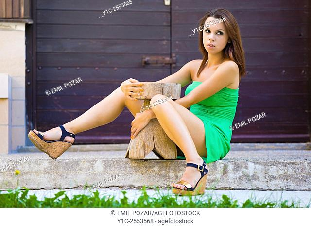 Teen girl is embracing wooden chair