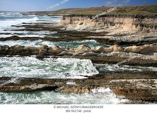 Wild Pacific Coast with erosion ridges and cliffs in Montana de Oro State Park near Morro Bay, California, USA