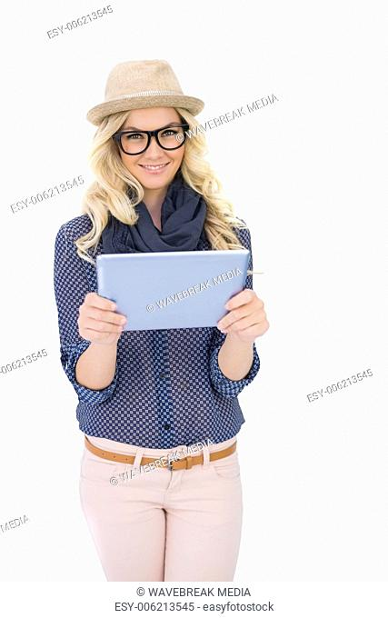 Happy trendy blonde holding tablet pc