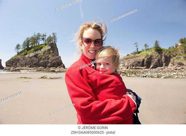 Woman with young child at beach