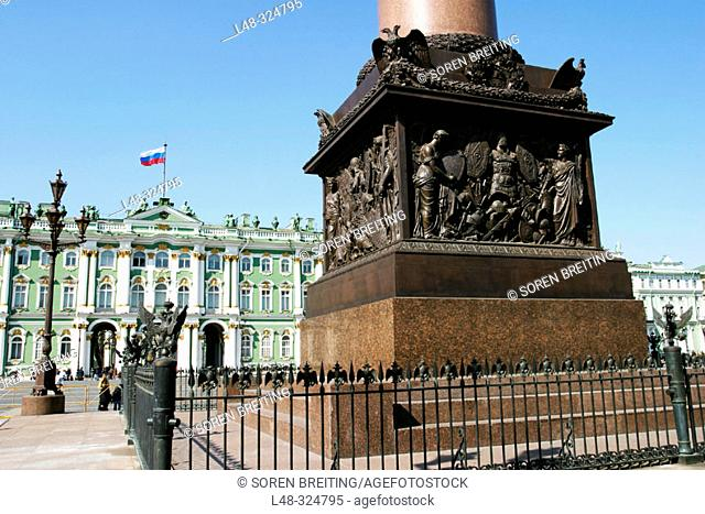 Aleksander column at Dvortsovaya Ploshchad or Palace Square in front of Winter Palace with The Hermitage Museum, St. Petersburg, Russia. Russian flag